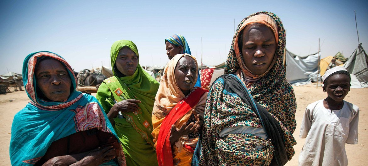 18 March 2014. Saraf Omra: A group of women in the new settlement for displaced people in the vicinity of the UNAMID base in Saraf Omra, North Darfur.
