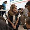Paloma Escudero, responsable de l'UNICEF, rencontre des familles de migrants à la frontière entre le Mexique et le Guatemala, en janvier 2019.