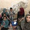 Ам Эхаб (справа) со своими сестрами и детьми в лагере для палестинских беженцев в Газе.