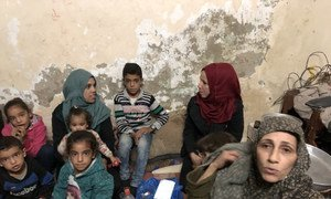 Om Ehab, right, with her sisters and children in her home in Beach Camp ifor Palestine Refugees in Gaza.