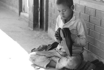 Young boy shining shoes in Kathmandu, Nepal (file).