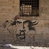 Graffiti on one of the walls in Benghazi destructed by the war