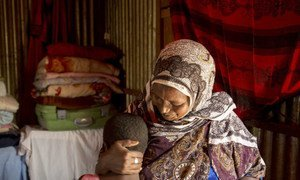 Female Genital Mutilation practitioner with her 10-year-old granddaughter in Diaami, Hargeisa in Somaliland. The young girl was supposed to have been cut already but she is sick with an infection so her grandmother is waiting.