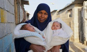 Haleema holds her two month old twins, in a camp for IDP's who fled the now destroyed Libyan town of Tawergha to the west of Benghazi.The Libyan Prime Minister and a key rival leader have pledged to hold a general election to help improve national stability.