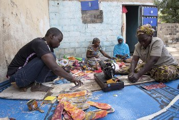 Cameroonians who have been displaced by Boko Haram attacks have been trained to make leather goods in order to generate income. (January 2019)