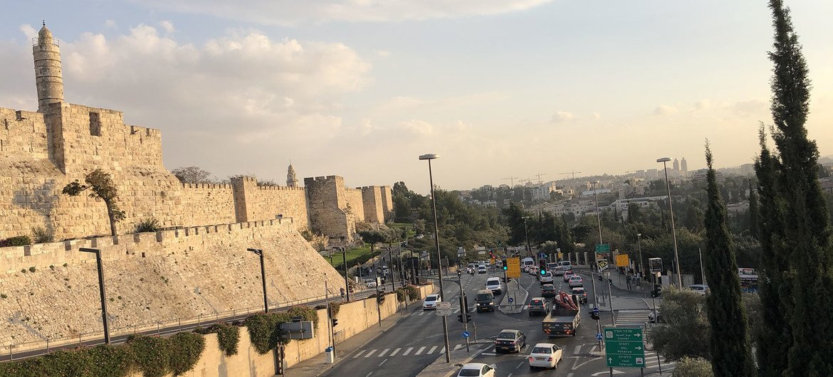 Traffic passes by the Old City in Jerusalem.