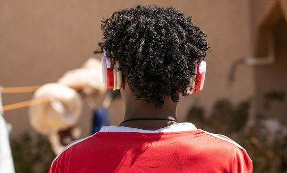 A young refugee from Eritrea, loves listening to songs in the headphones he found on his way to Niger. More than a billion risk irreversible hearing loss from playing music too loud on smartphones and other devices, WHO and the ITU have reported.
