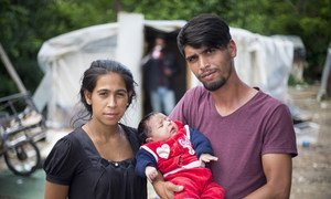 Ajnur Demir poses for a portrait with his family while attending a UNHCR stateless workshop in Skopje, North Macedonia.