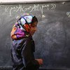 Afghanistan's education system has been devastated by more than three decades of sustained conflict. For many of the country's children, completing primary school remains a distant dream. Here, 10-year-old Fatima is on the board to solve a math question, at the ALC in Baghe Mellat, Herat.