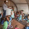On 1 October 2018 at the Junaina makeshift camp in northern rural Idlib, in the Syrian Arab Republic, girls study in a tent school where a total of 350 children between the ages of 7 and 14 are able to go back to learning.