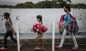 Venezuelan refugees and migrants cross the Simon Bolivar Bridge into Colombia, one of seven legal entry points on the Colombia-Venezuela border.