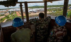 Members of the Nepalese battalion man a guard post that overlooks a protection-of-civilians site in Juba in May 2015. Nepalese forces help to protect civilians in South Sudan by patrolling across the country, facilitating the safe delivery of humanitarian aid and providing a secure environment for displaced people living in UN protection camps.