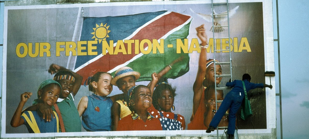 Namibia's struggle for independence had been on the UN agenda for over 40 years. Pictured here is a worker puts the finishing touches to a billboard near Windhoek, proclaiming the nation's independence.