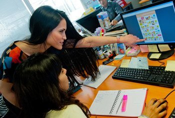 """Soukaina (left) and Mouna work in the marketing department at Label Vie's corporate headquarters in Rabat. It has 35 supermarkets and 10  """"hypermarkets"""" nationwide, with eight supermarkets in Rabat and one hypermarket in Salé."""