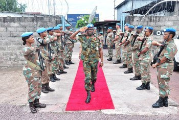 Brigadier General Emmanuel Wekem Kotia, the Commander of the Western Sector in the UN Peacekeeping Mission in the Democratic Republic of the Congo (MONUSCO), surveying troops.