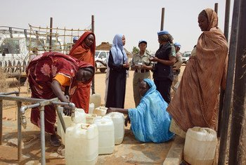 Members of the Formed Police Unit of the African Union-United Nations Hybrid Operation in Darfur from Ghana, Indonesia and Nigeria conduct daily patrols to monitor the security situation in the Zam Zam camp for internally displaced persons in April 2009.