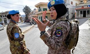 UNIFIL Malaysian peacekeeper, Major Syazwani, gives instructions to her fellow peacekeepers while patrolling in Rumaysh, south Lebanon in December 2017.