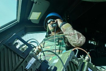 A UNIFIL radio operator from Malaysia communicates from his armoured personnel carrier while on duty in Marakah, south-west Lebanon. (file)