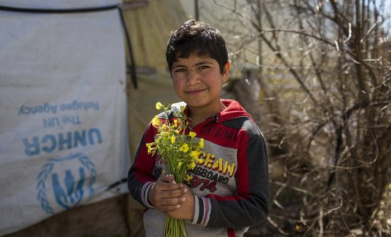 A Syrian refugee boy in Lebanon, who is the same age as the war that has engulfed his country for the past eight years.