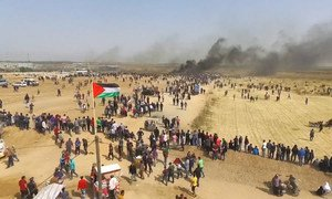 """Drone shot, protesters walking towards the Gaza separation fence, with Israel. The anniversary of the """"Great March of Return"""" protests, falls on 30 March, 2019."""