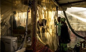 Parents visiting her 15-year-old daugher, who is suspected of being infected by Ebola, at the Ebola Treatment Center in Beni, DRC (January 2019).