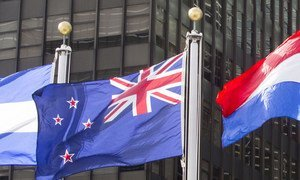The flag of New Zealand (centre) flying at United Nations headquarters in New York.