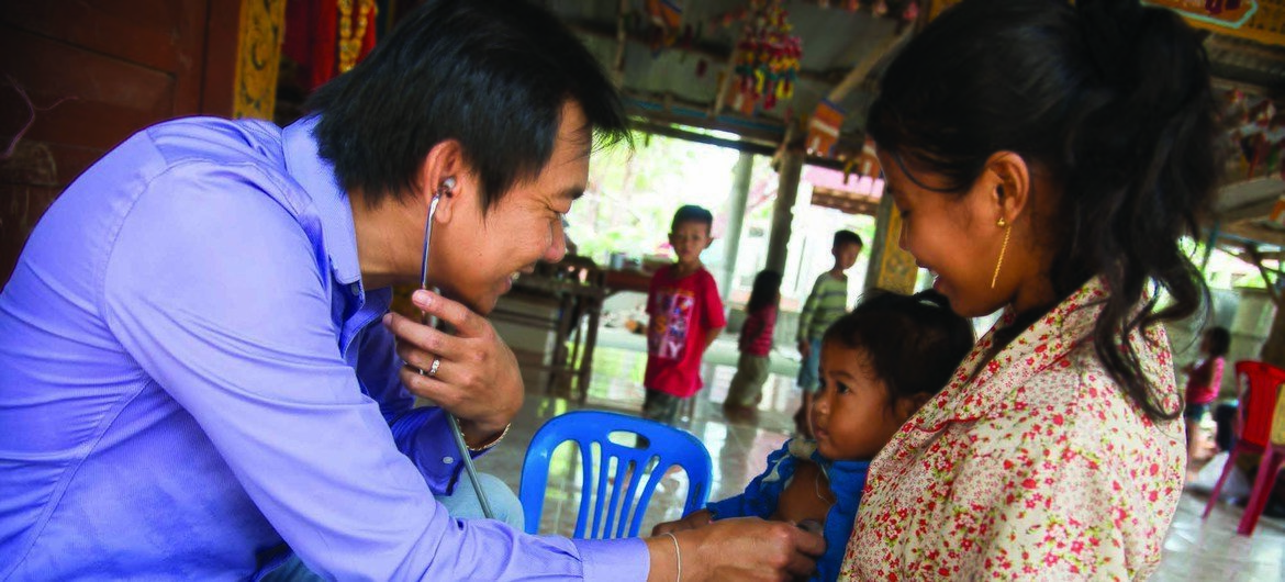 Doctor examining child in Cambodia, member state of the South-South cooperation.