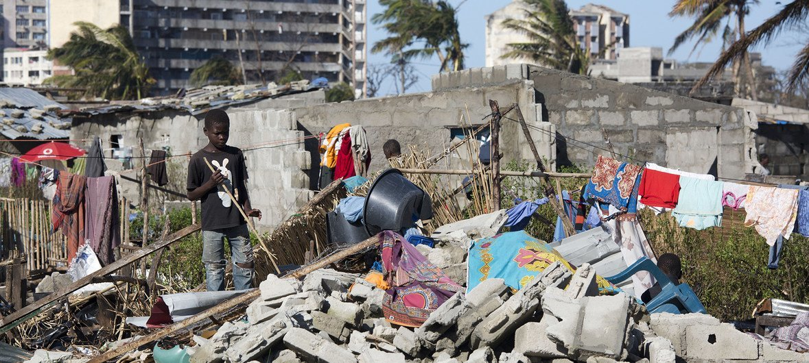 boy stands near a destroyed house in an area flooded after Cyclone Idai made landfall in Beira (file)