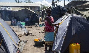 Esther next to a tent she lives in at a camp set up for displaced people at the Jehovas Witness Centre in Dondo, Mozambique. Cyclone Idai displaced thousands of people.