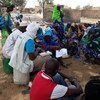 UNICEF field staff meet with the local population in Bankass, central Mali, which was attacked on 23 March, leaving over 150 people dead, 2000 displaced and numerous huts and granaries burnt.