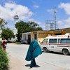 A woman walks past an Aamin Ambulance vehicle inside Benadir Hospital in Mogadishu, Somalia. (file)