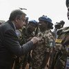 Secretary-General António Guterres awards a medal to a peacekeeper from the Nigerian contingent of MINUSMA during the wreath-laying ceremony to honour peacekeepers killed in the line of duty, Bamako, May 2018.