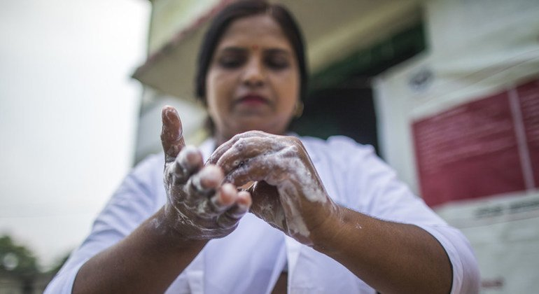 An Auxiliary Nurse Midwife washes her hands before she examines a pregnant woman in Shrawasti, India.