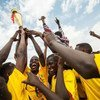 Football players celebrate the first prize at the closing ceremony of the community football competition in Zam Zam camp for internally displaced persons in North Darfur.
