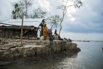 A family left homeless by cyclone Aila wait for assistance in Koira, Khulna District, Bangladesh.