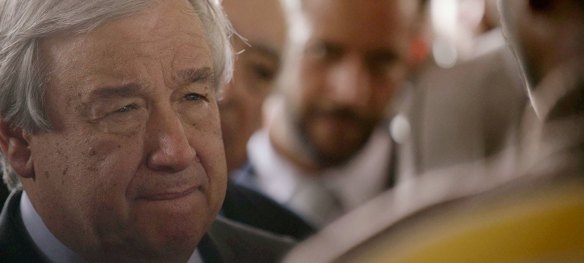 Secretary-General of the United Nations António Guterres listening to migrants and refugees during his visit to Ain Zara Detention center in Tripoli, Libya. 4 April, 2019.