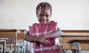 Six-year-old girl in Beira receives her education pack as part of UNICEF's ramped-up response to children and families in Mozambique affected by Cylcone Idai, April 2019.
