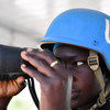 A female Ugandan soldier serving under the United Nations Guard Unit (UNGU) scans the horizon through a pair of binoculars while on duty at a security tower in Mogadishu, Somalia.