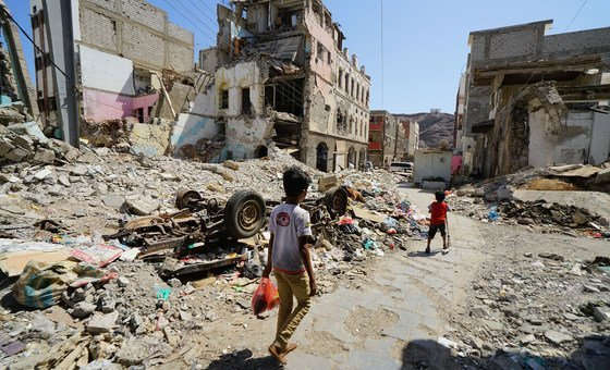 Children walk through a damaged part of downtown Craiter in Aden, Yemen. The area was badly damaged by airstrikes in 2015 as the Houthi's were driven out of the city by coalition forces.