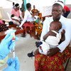 Nurse at Redemption Hospital in Monrovia, Liberia, prepares to vaccinate children.