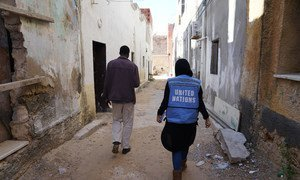 In the streets of Tripoli, Libya, a UNOCHA staff member visits a Sudanese caregiver's house, before the recent clashes began. (February 2019)