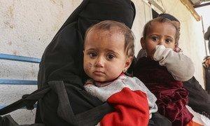 Deux jumeaux âgés de neuf mois avec leur mère ont fui le village de Susa pour trouver refuge au camp d'Al Hol, en Syrie (janvier 2019)