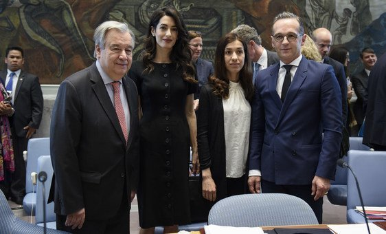 Secretary-General António Guterres (left) with (from left to right) Amal Clooney, Barrister; Nadia Murad, Nobel Peace Prize Laureate and Goodwill Ambassador for the Dignity of Survivors of Human Trafficking of the UN Office on Drugs and Crime (UNODC); and Heiko Maas, Federal Minister for Foreign Affairs of Germany and President of the Security Council for the month of April.