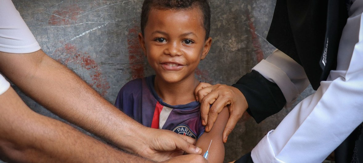 A child smiles while receiving a Measles and Rubella vaccination during a UNICEF-supported mobile vaccination campaign in Aden, Yemen, February 2019.