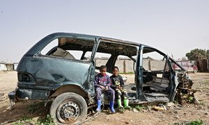 IDP Tawerghan children in a damaged car in the Qaryounis IDP settlement in Benghazi. The Qaryounis settlement is home to 204 families almost all of whom were displaced from Tawergha in 2011.
