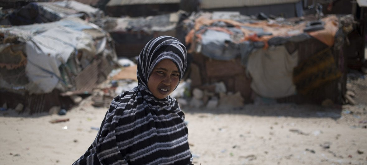 Seventeen-year-old Ideeya Jimcaale at her home in a camp for internally displaced persons on the beach in Bossaso, Puntland, Somalia (2018).