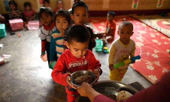Local school children eat their meals at the Ban Bor Primary School in Xay District, Lao People's Democratic Republic. (14 May 2019)