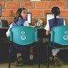 Two schoolgirls make use of classroom computers at San Jose, a rural secondary school in La Ceja del Tambo, Antioquia, Colombia.