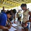 Migrantes y refugiados venezolanos reciben ayuda en Boa Vista, Roraima, Brasil.