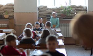 In Mariinka, eastern Ukraine, evacuation drills and learning how to take cover in the school's underground bomb shelter have become part of students' education.